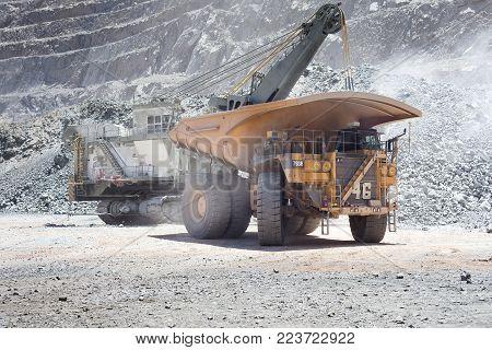 Copiapo, Region de Atacama, Chile - January 17, 2012: Huge dump trucks in an open pit Copper mine at northern Chile.