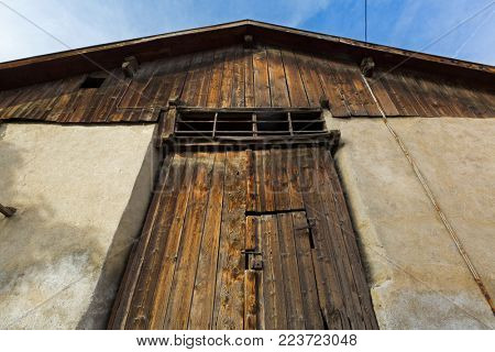 Entrance with rustic weathered barn wood made of natural wood in Italy