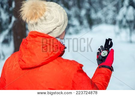 The Girl Is Guided In The Winter Forest By The Compass, The View From The Back