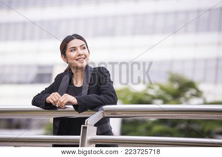 Young Beautiful Asian Woman In City Looking Out And Thinking About Work. Young Business Woman With L