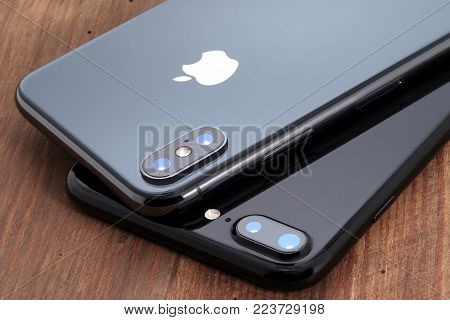 Koszalin, Poland - November 29, 2017: Space gray iPhone X and black iPhone 7. The iPhone X and iPhone 7 is smart phone with multi touch screen produced by Apple Computer, Inc.
