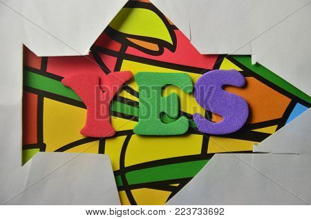 word yes on an   abstract colored background