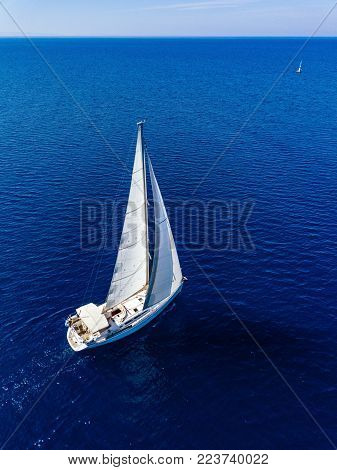 Aerial  View From Drone Of Yacht In Deep Blue Sea