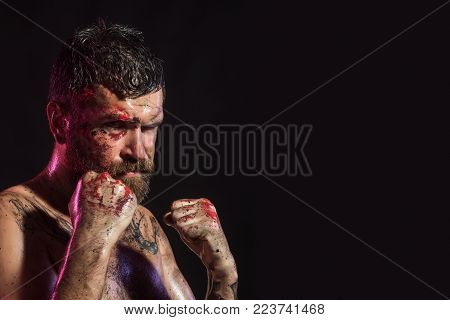 Man In Fight Position With Blood Paint On Face, Fists. Bearded Hipster With Tattoo On Chest Skin On