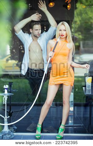 Woman Sensual With Hookah Pipe In Bar. Couple Man With Girl At Shisha Cafe Lounge. Date, Love, Relat
