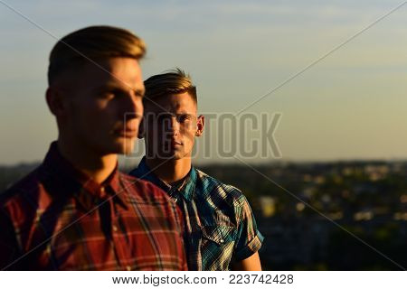 Twins Man In Sunset Blue Sky, Copy Space. Twins Brother, Support, Partnership, Family.