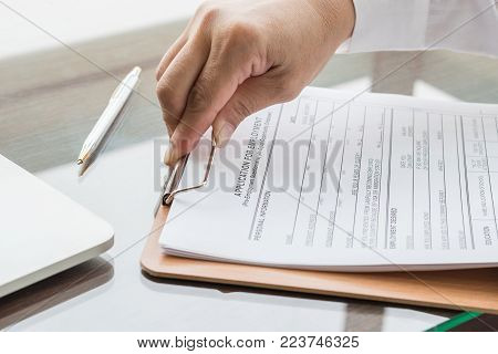 Applicant Filing In Company Application Form Document Applying For Job, Or Registering Claim For Hea
