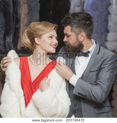 fur coat, sensual woman with man in shop. fur coat, couple in love, shopping.