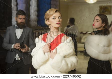 People among fur coat, envy, betrayal, luxury. Date, family, love, man, women. Women in fur coat with man, shopping, seller and customer. Fashion, beauty, winter, fur. Purchase, business, moneybags.