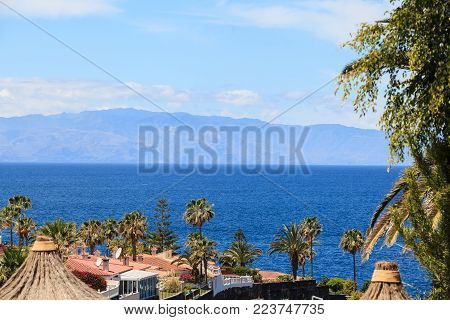 residential apartments of Los Gigantes, Tenerife, Spain. La Gomera island on the background