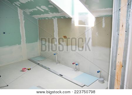 Remodeling attic bathroom with  drywall repair, plastering painting, stucco. Bathroom repair and renovation with gypsum plaster boards