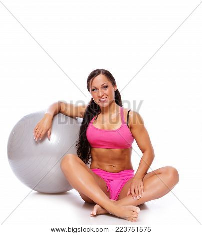 Portrait of joga trainer with grey fitball