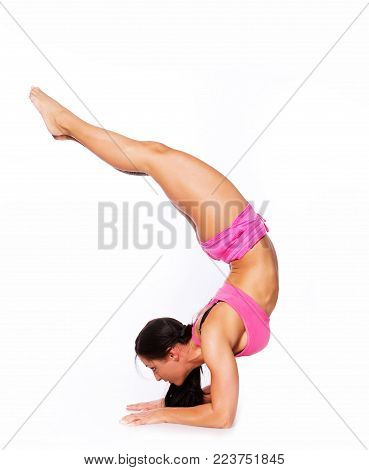Portrait of muscle woman doing exercises in yoga