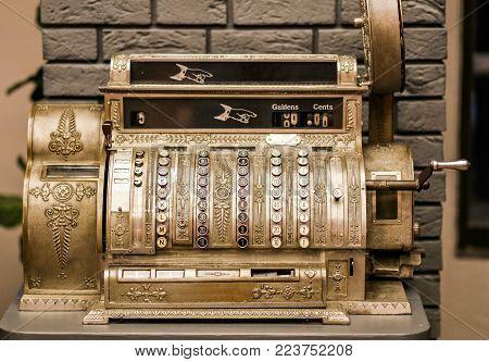 Antiques, an old cash register. Close - up