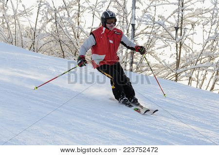 25 January 2018 - Moscow, Russia. Elderly man skiing down ski slope