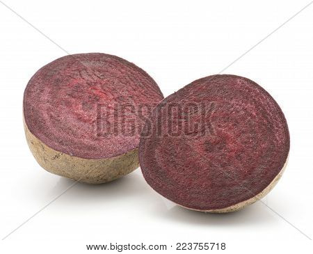 Beetroot (raw red beet) isolated on white background one bulb cut in half