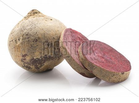One beetroot (raw red beet) bulb and  two sliced rings isolated on white background