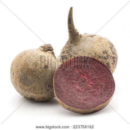 Two beetroot (raw red beet) bulbs and  one slice isolated on white background