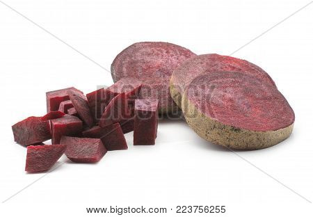 Sliced beetroot (raw red beet) three ring slices and chopped pieces isolated on white background
