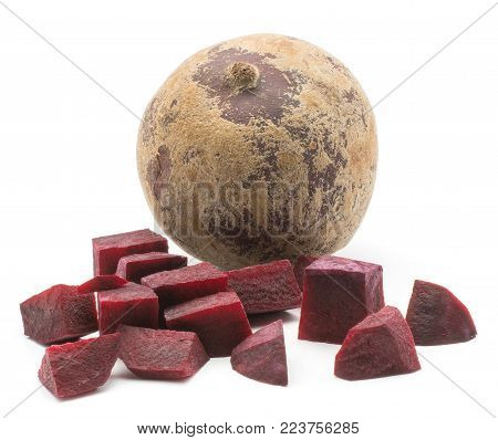 Chopped beetroot (raw red beet) pieces and one whole bulb isolated on white background