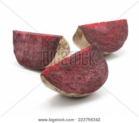 Three beetroot slices (raw red beet) isolated on white background