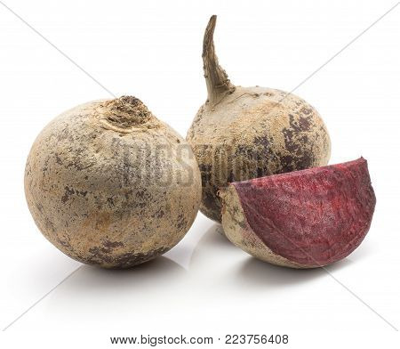Two beetroot bulbs and one slice (raw red beet) isolated on white background