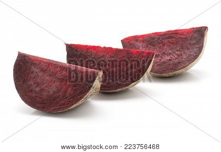 Three beetroot slices in row (raw red beet) isolated on white background