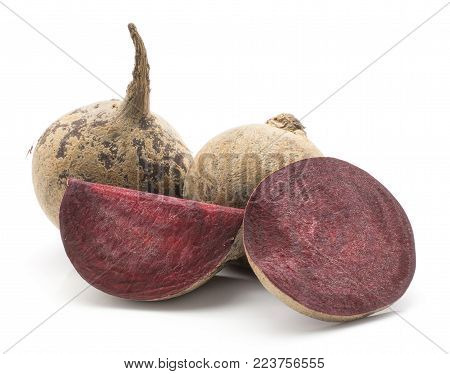 Beetroot (raw red beet) isolated on white background two bulbs sliced ring and a slice