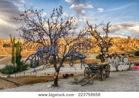 Goreme, Turkey - September 23, 2015: Tree Of Wishes with clay pots in Cappadocia. Nevsehir Province, Cappadocia, Central Anatolia, Turkey