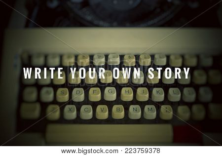 Motivational and inspirational quotes - Write your own story. With blurred vintage styled background.