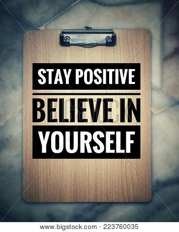 Motivational and inspirational quotes - Stay positive, believe in yourself. With blurred vintage styled background.