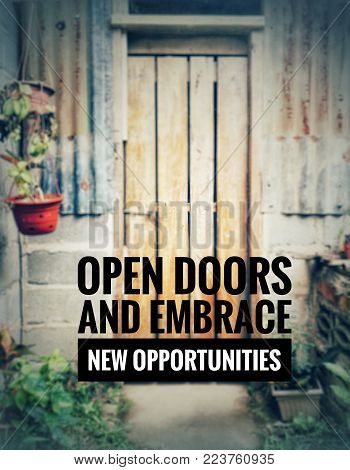 Motivational and inspirational quotes - Open doors and embrace new opportunities. With blurred vintage styled background.