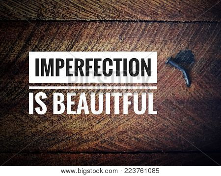 Motivational and inspirational quotes - Imperfection is beautiful. With blurred vintage styled background.
