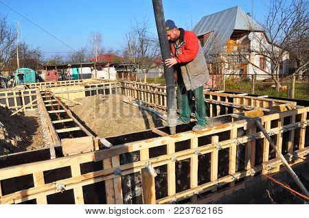 KYIV, UKRAINE - February, 05, 2018: Foundation building. Pouring a concrete slab formwork along the foundation.