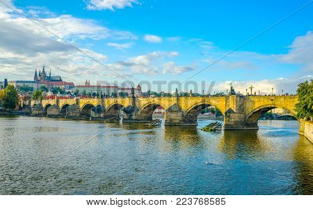 Prague Castle And Charles Bridge In Prague, In The Czech Republic At Sunset. St. Vitus Cathedral. Th