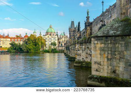 Charles Bridge In Prague In The Czech Republic. Catholic Church Of St. Franciszek Of Serafin. Sculpt