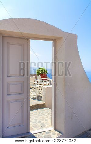 Doorway to a balcony overlooking the mediterranean sea. Thira, Santorini, Greece.