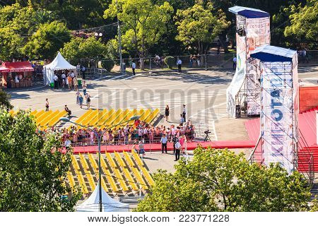 Sochi, Russia- June, 7, 2015: people wait for movie stars along the red carpet of Sochi Winter theater, the venue of cinema festival Kinotavr. Preparation for the evening premiere of the next film
