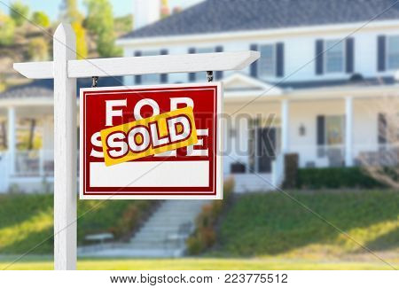 Right Facing Sold For Sale Real Estate Sign In Front of House.