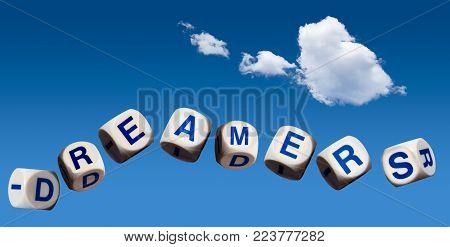 Dreamers children spelling letters on blue sky to illustrate dreaming of the future