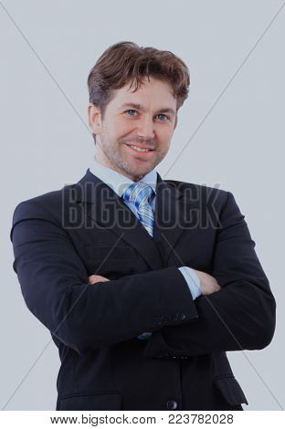 Isolated portrait of a senior executive businessman. Cheerful and in a suit.
