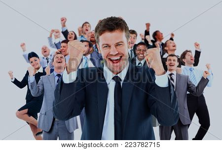 large business team celebrating success with arms raised isolated against white background.