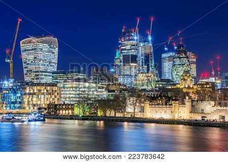 LONDON, UNITED KINGDOM -JANUARY 05: Night view of the City of London modern skyscrapers on January 05, 2018 in London