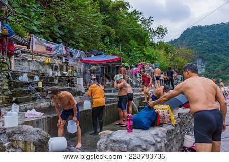 TAIPEI, TAIWAN - NOVEMBER 29: Local Taiwanese people bathing in Wulai hot spring village a famous village in rural Taipei on November 29, 2016 in Taipei