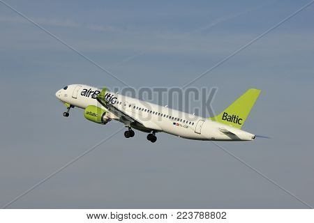 Amsterdam, the Netherlands  -  June 2nd, 2017: YL-CSB Air Baltic Bombardier BD-500 taking off from Polderbaan Runway Amsterdam Airport Schiphol