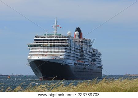 IJmuiden, The Netherlands - June 5th 2017: Queen Victoria, Cunard on North Sea Channel towards North Sea Lock in IJmuiden