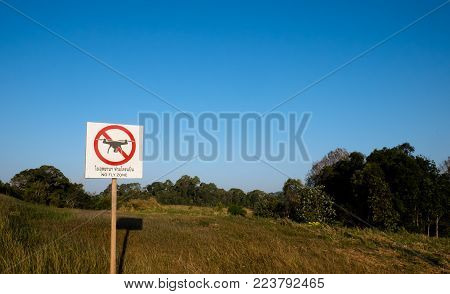 The sign forbidding flying drone and background