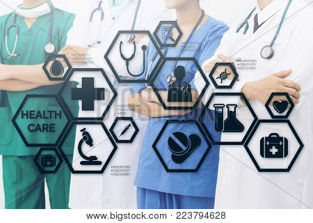 Medical Healthcare Concept - Doctors in hospital with medical icons modern interface showing symbol of medicine, innovation, medical treatment, emergency service, doctoral data and patient health.