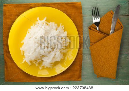 daikon on a wooden background. daikon on a plate
