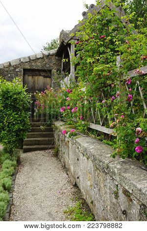 Neat garden path along a stone wall in rural Scotland